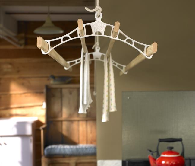 Our classic Pulley Maid clothes airer dyer in white. The laundry rack has the pulleymaid logo cast into the centre of each rack end.