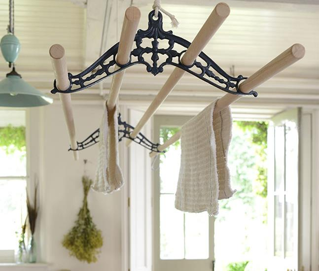 Our elgain pulley maid ceiling clothes airer laundry drying rack with black cast iron rack ends. Suspended from the ceiling its operated using a pulley system.