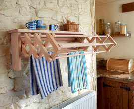 Wooden drying rack made of beach with extendable arms